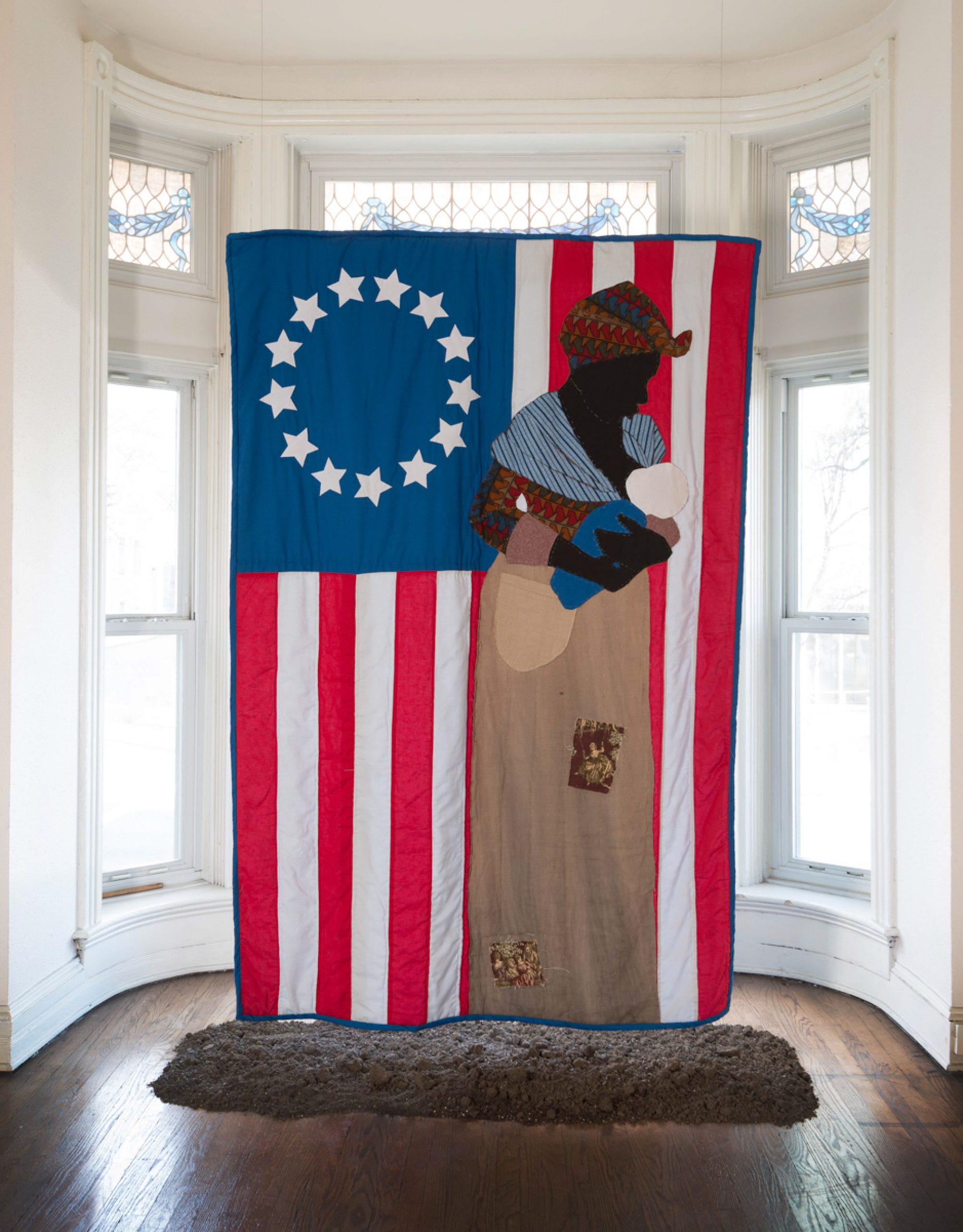 Stephen Towns, Birth of a Nation, 2014. Natural and synthetic fabric, polyester and cotton thread, metallic thread, coffee and tea stain, acrylic paint. 90 x 66 inches. Private collection.