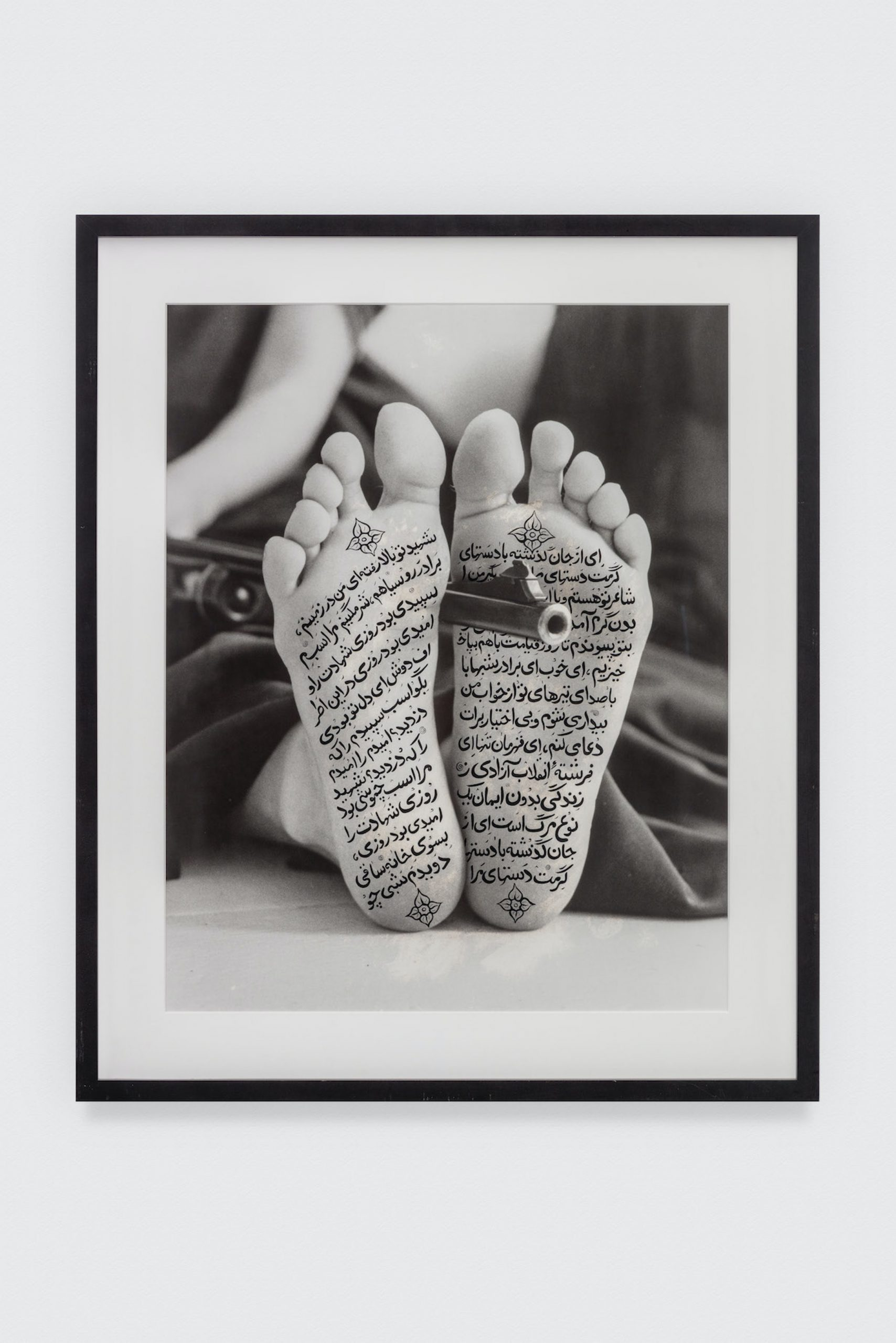 Shirin Neshat. Allegiance with Wakefulness, 1994. Black & white photograph with ink. 48 x 39 1/4 in. © Shirin Neshat. Courtesy of the artist and Gladstone Gallery, New York. The Eileen Harris Norton Collection. Photo: Charles White.