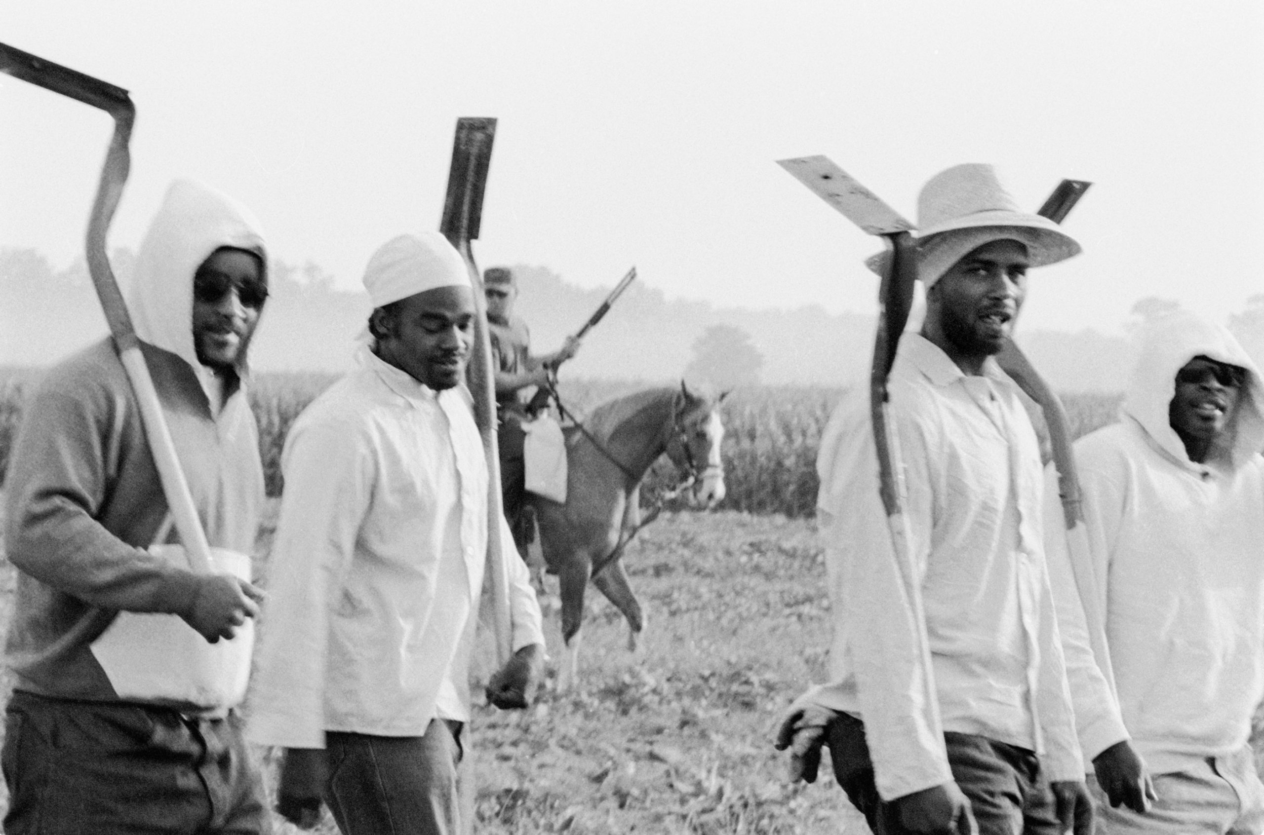 Chandra McCormick, Men Going to Work in the Fields of Angola, 2004. Archival pigment print. Courtesy of the artist.