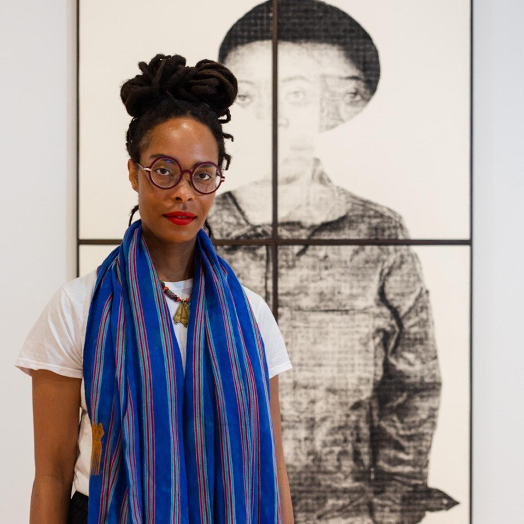 Artist Kenturah Davis in front of her work at the California African American Museum in Los Angeles, California. Photo by HRDWRKR.