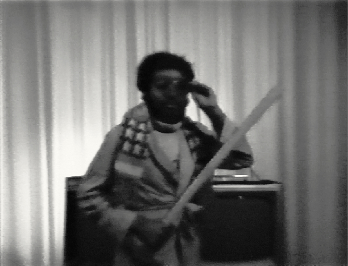 Ulysses Jenkins, Mass of Images (1978). Still from black and white video with sound, 4:15. Performance by Ulysses Jenkins. Video by Bob Dale. Courtesy of the artist.