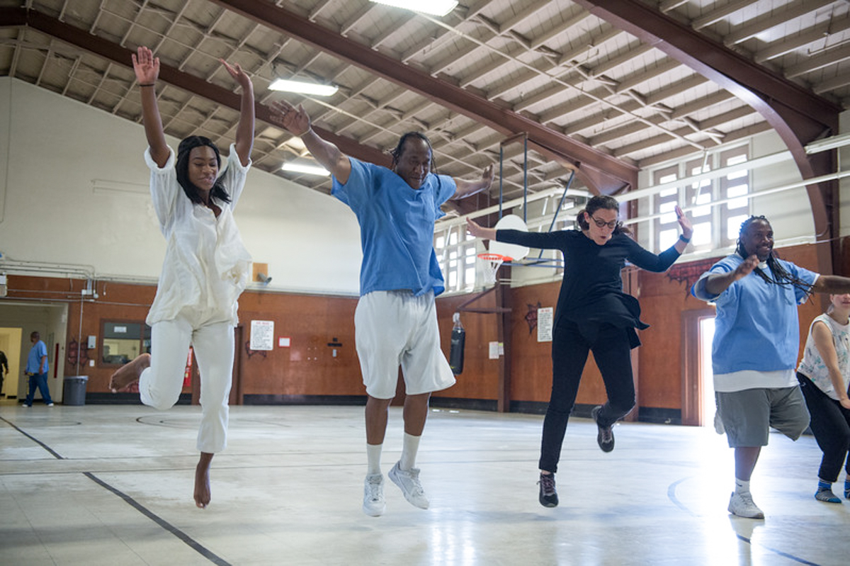 Suchi Branfman dances with incarcerated men at the California Rehabilitation Center in Norco, CA. Photo by Cooper Bates.