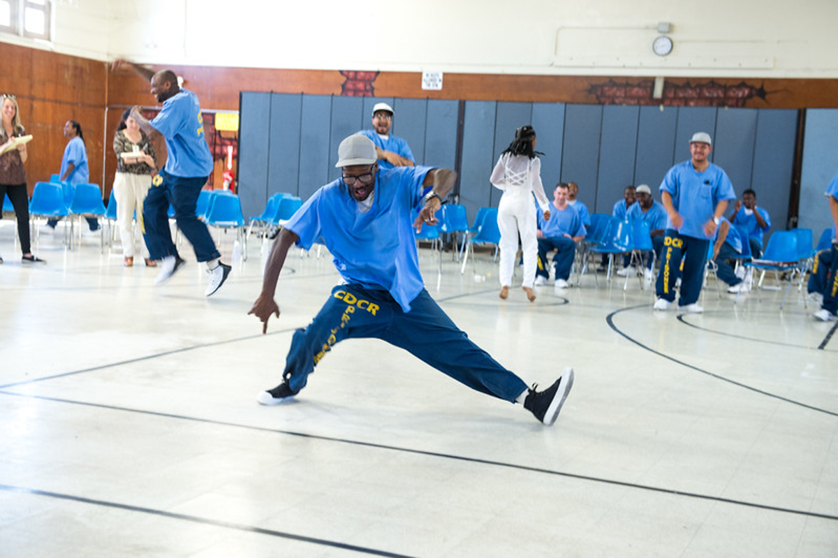 An incarcerated man dances as part of Inside Outside, organized by Suchi Branfman, at the California Rehabilitation Center in Norco, CA. Photo by Cooper Bates.