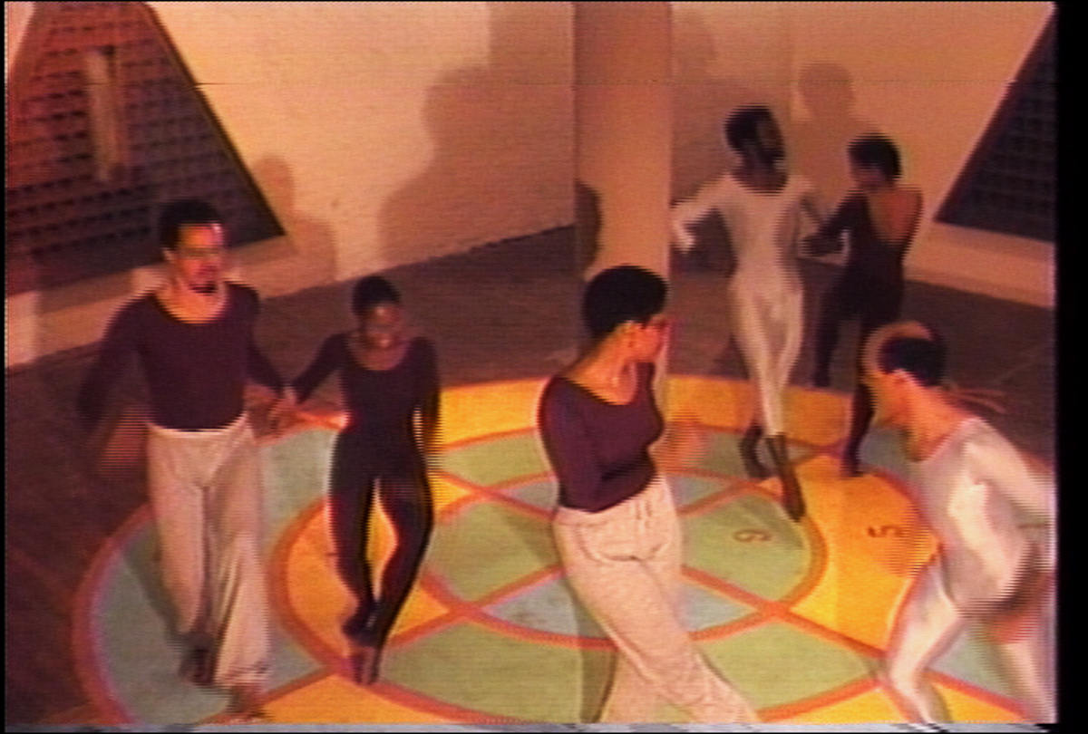 Cake Walk (1983). Still from color video with sound, 26:28. Performance by Houston Conwill. Video and editing by Ulysses Jenkins. Courtesy of the artist.