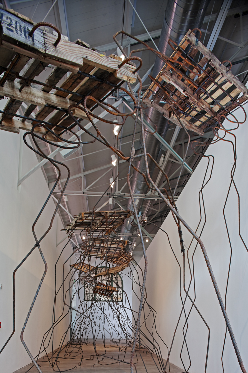 Ruben Ochoa, Watching, Waiting, Commiserating, 2010.  Wooden pallets and rebar. 18 x 16 x 80 feet. Courtesy of the artist and Susanne Vielmetter Los Angeles Projects. Photo by Pablo Mason.