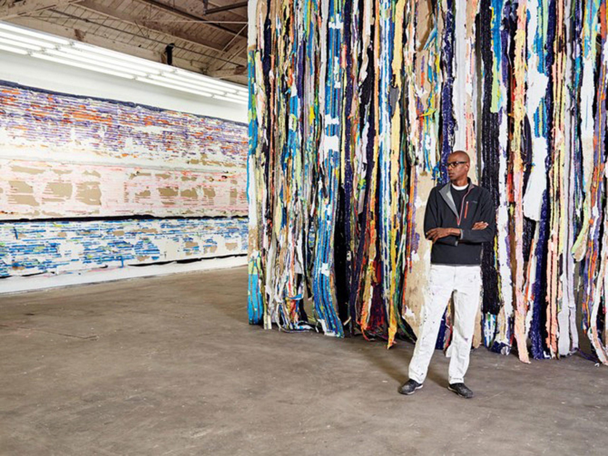 Mark Bradford with recent work in his Los Angeles studio. Photo courtesy of Manfredi Gioacchini.