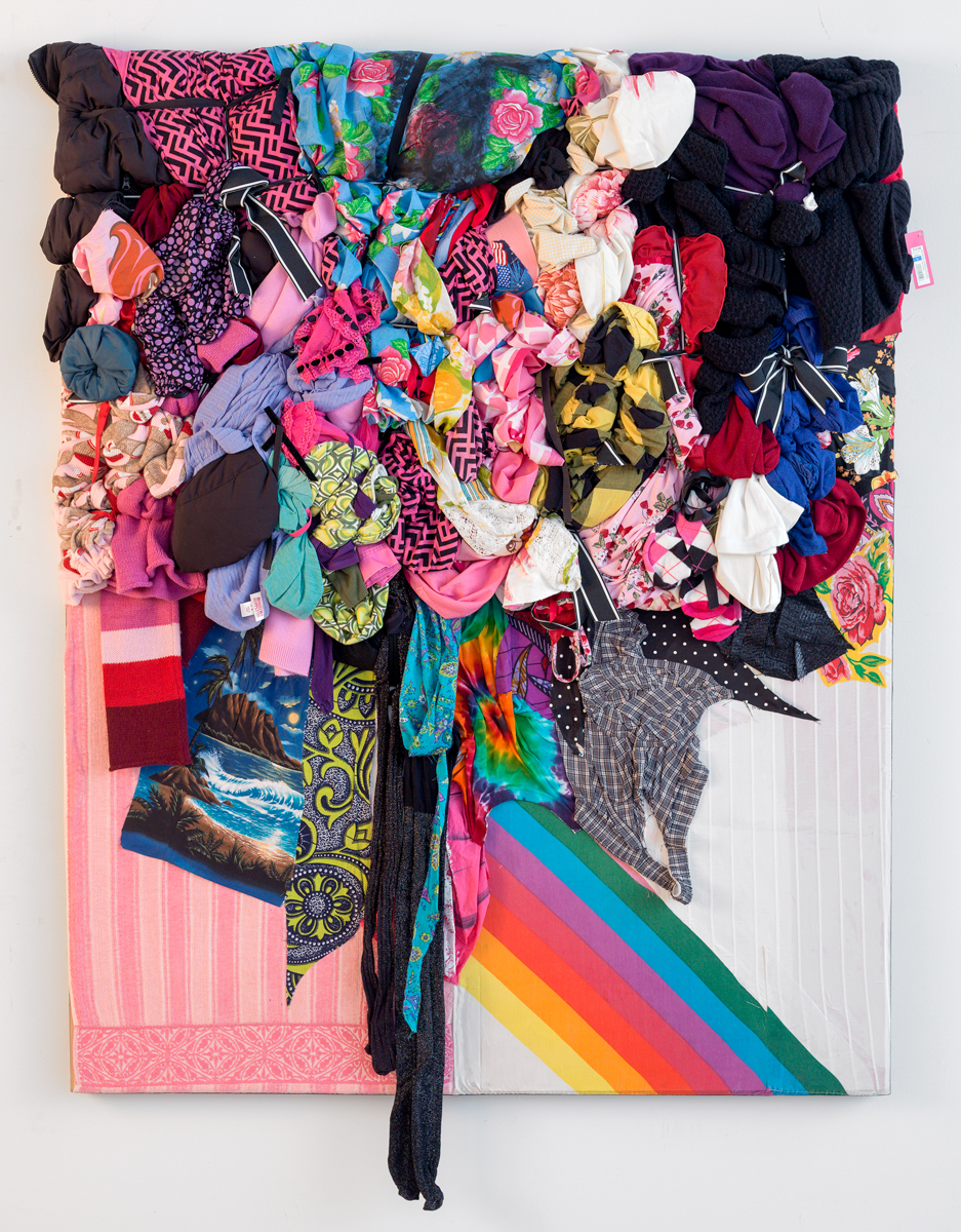 Shinique Smith, Bright Matter, 2013. Clothing and fabric culled from Los Angeles and ribbon on wood panel, 63 x 52 x 5 inches.